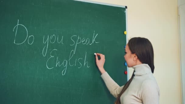 teacher or student writing on blackboard. Back to school. Education concept