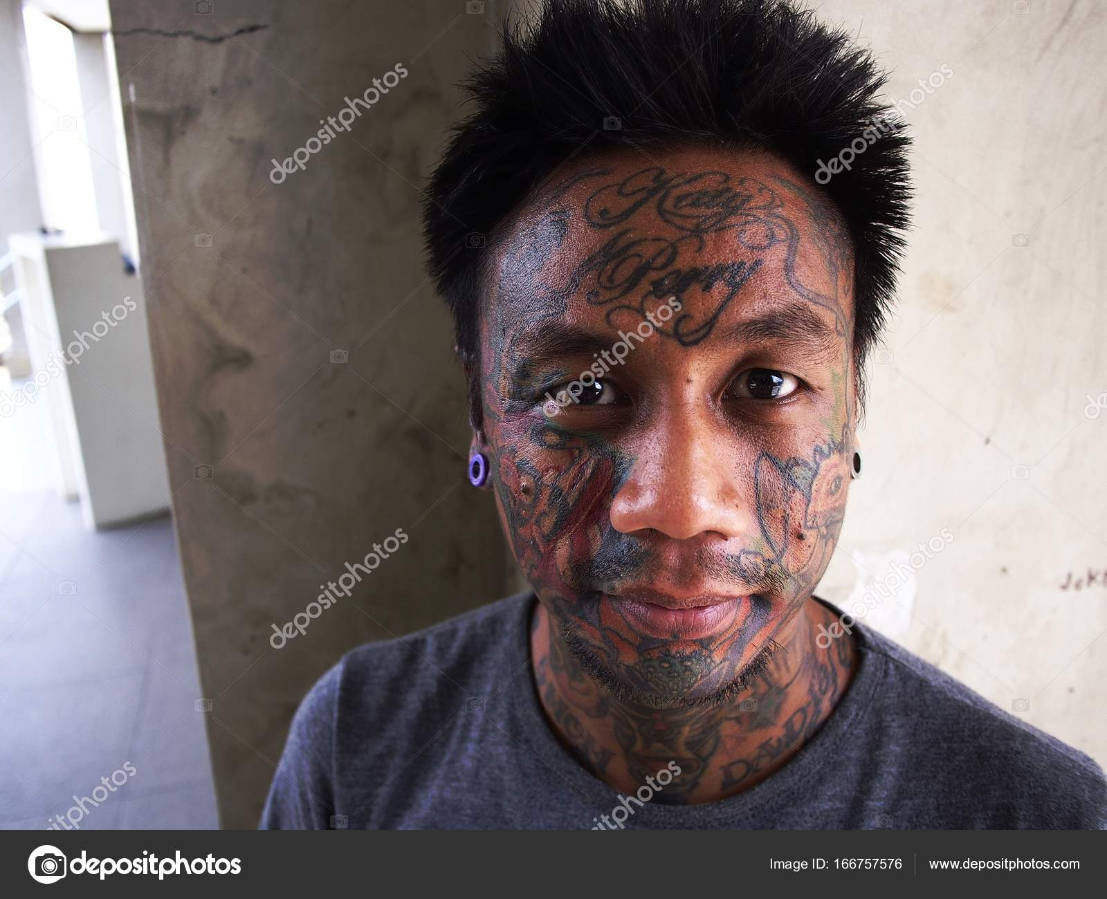Pictures Facial Tattoos A Man With Body Art Shows Off His Facial Tattoo And Ear Piercing Stock Editorial Photo C Junpinzon 166757576