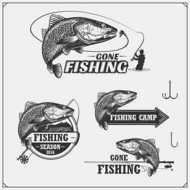 Set of retro fishing labels, badges, emblems and design elements. Vintage style design.