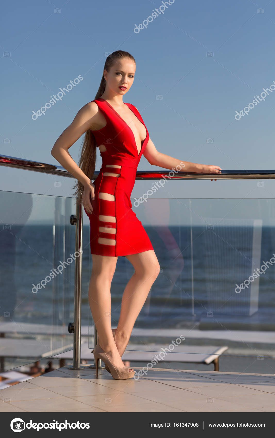 a sexy woman in a stunning red dress and high heels on a hotel's
