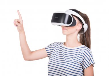 A young woman is using a 3D virtual reality headset, isolated on a white background. New and professional audio equipment. A girl in virtual reality goggles. VR Glasses.
