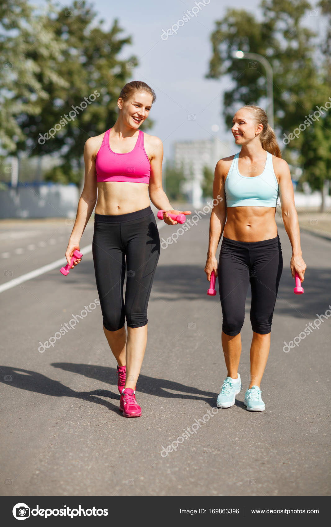 Sexy Sports Girls With Bottles Of Water Walking On A Park Background Fitness Concept Copy Space Stock Photo Image By C Alfa4studio 169863396