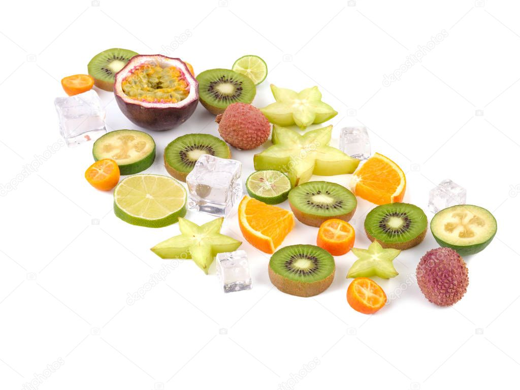 Fresh tropical slices of fruits isolated on white background. Juicy exotic carambolas, lime, litchi, oranges, and mango.