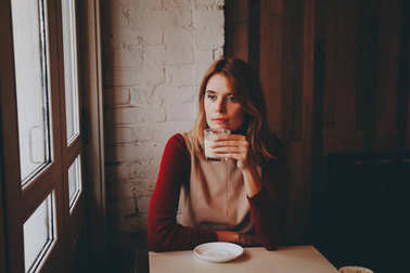 Girl with a cup of coffee latte.