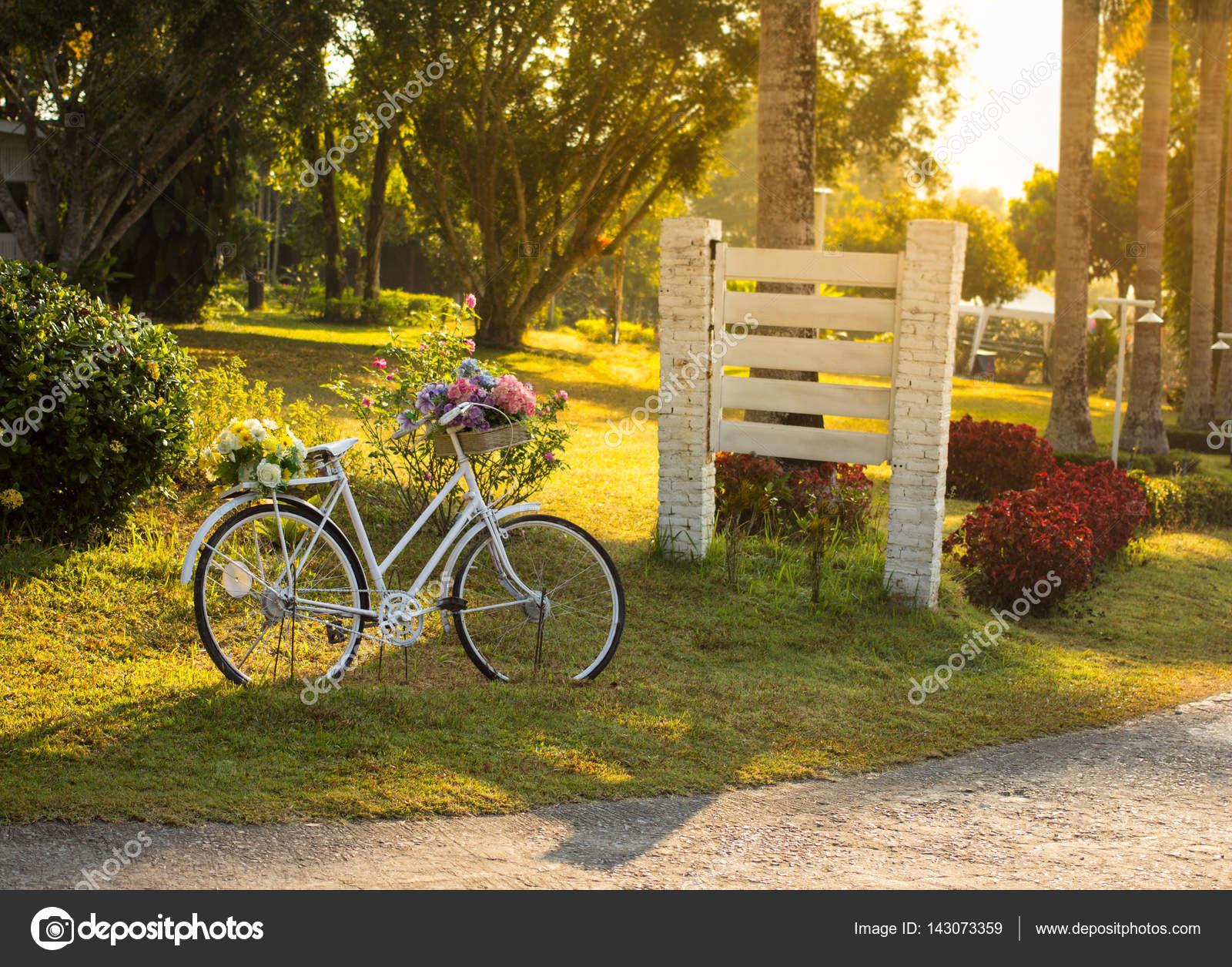 Vintage bicycle decoration in garden — Stock Photo © samsam62 #143073359