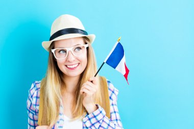woman holding French flag