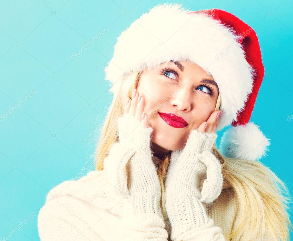 woman in Santa hat posing