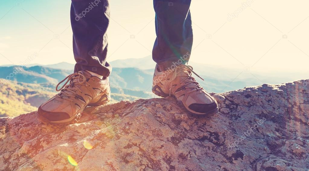 male feet on edge of cliff