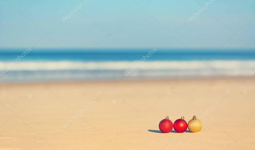 Christmas ornaments on a tropical beach