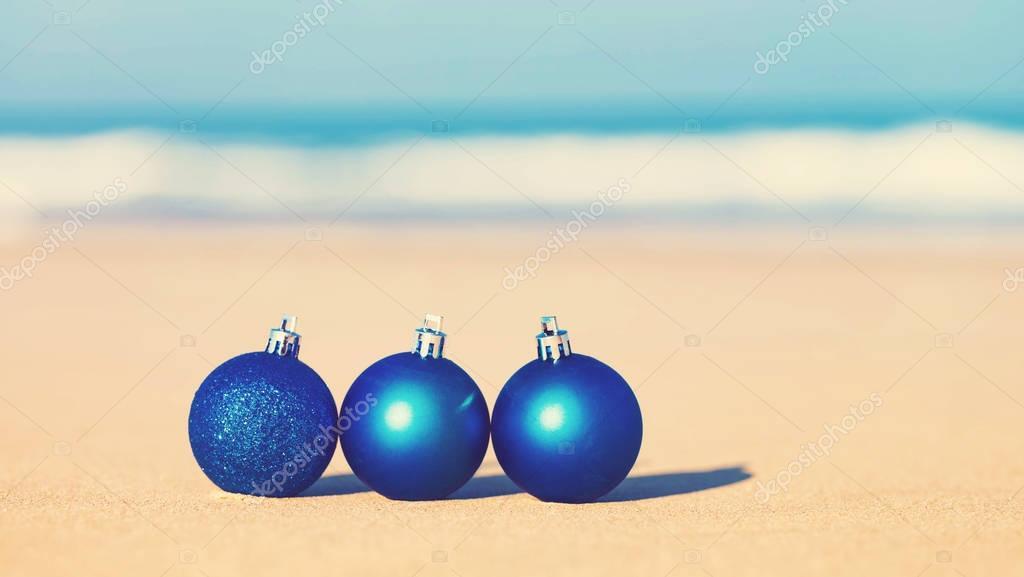 Christmas ornaments on a tropical beach