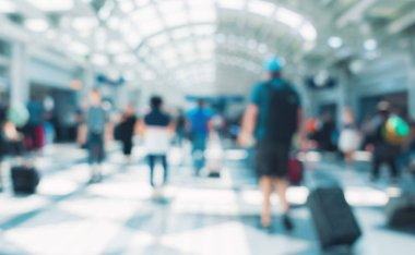 Blurred airport interior with people