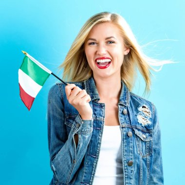 Young woman holding Italian flag