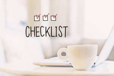 Checklist concept with cup of coffee