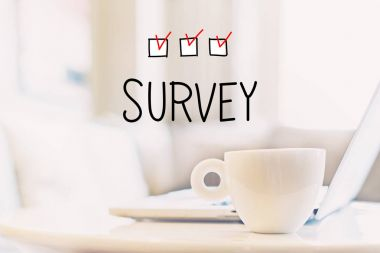 Survey concept with cup of coffee