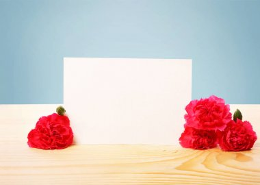 Blank Greeting Card with Carnation Flowers on the Table