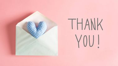 Thank You message with a blue heart cushion