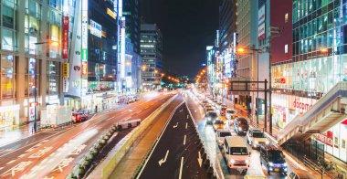 Traffic and people moving through Osaka at night