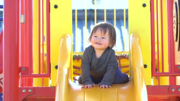 Toddler boy playing on the playground