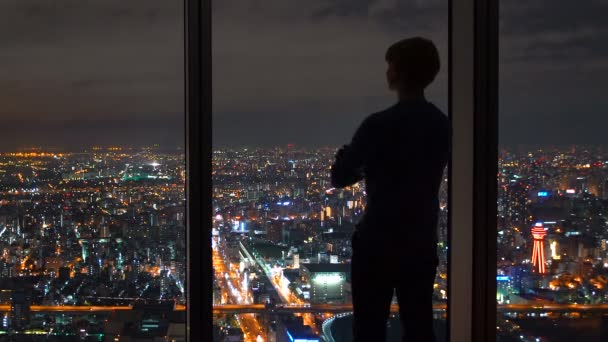 Man Looking Out A Window High Above The City Stock Video