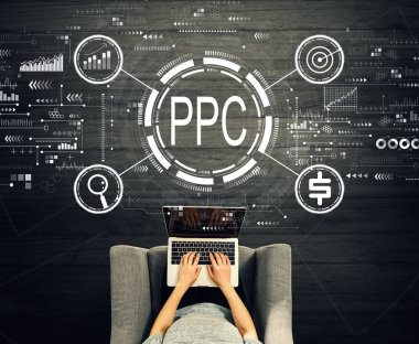 PPC - Pay per click concept with person using a laptop