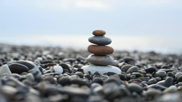 pyramid of stones by the sea. zen balanced stones