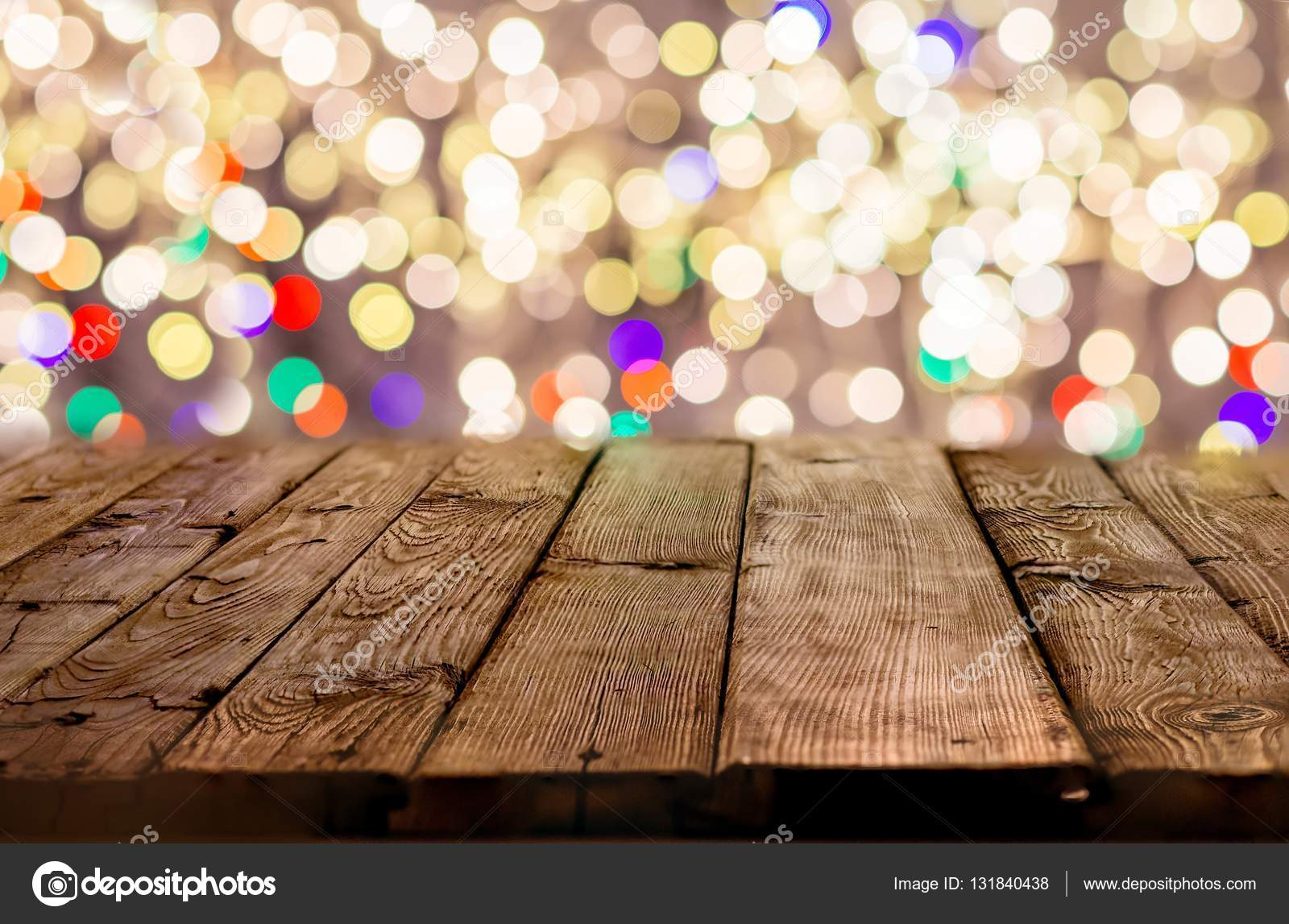 Old empty table with christmas lights in the background — Stock ...
