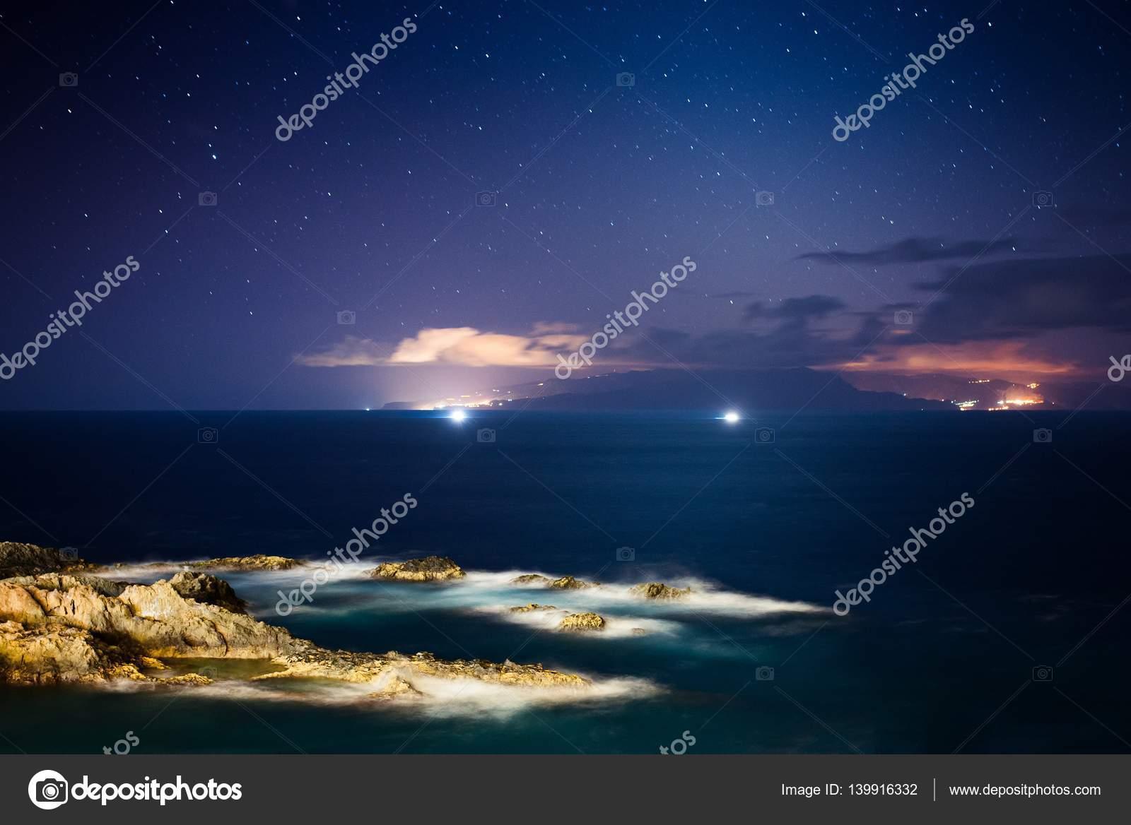 Beautiful Night View On Ocean And Rocks. Starry Night. Los Gigantes, Puerto  De Santiago, Tenerife, Canary Islands. U2014 Photo By Djedzura