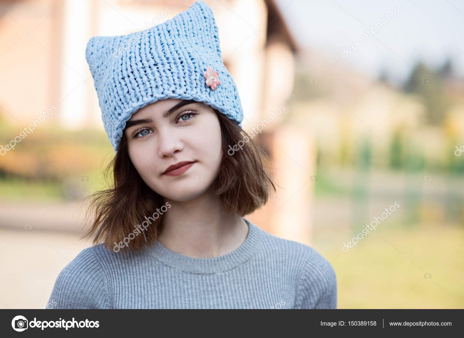 58bd69b8c2f2 Portrait of young hipster girl in grey wool cap — Stock Photo ...