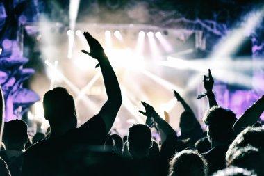 Concert crowd applauding