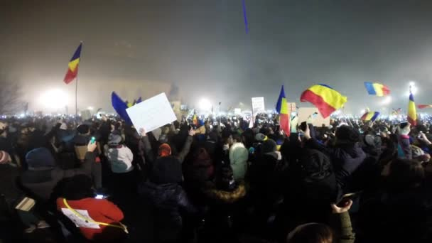 Crowd of people singing the National Anthem of Romania