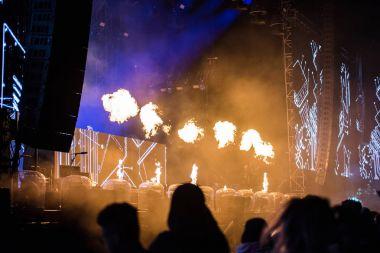 Flame projectors on a live EDM concert