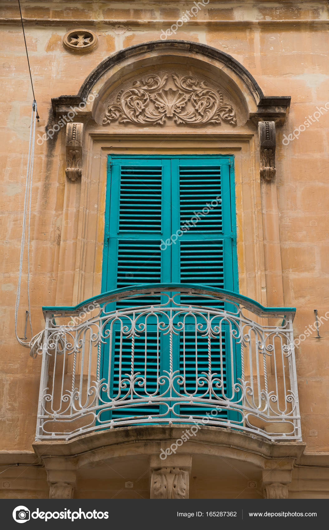 Closed Blue Window Shutters And A Small Balcony Stock