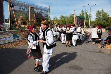 Romanian folk dancers dancing in traditional costumes