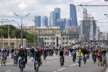 Many people ride bicycles in Moscow city center.