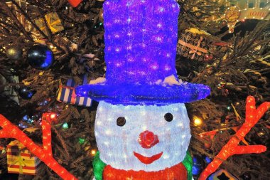MOSCOW - DECEMBER 24, 2017: Snow man. Christmas decorations on the Red Square in Moscow. Popular landmark. Color night photo.