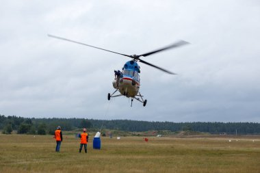 Pilots of the helicopter perform aerobatics