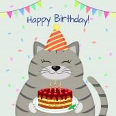 Fényképek Egy szürke fat-macska, a Cap ül, és tart egy tortát mancsait. boldog születésnapot