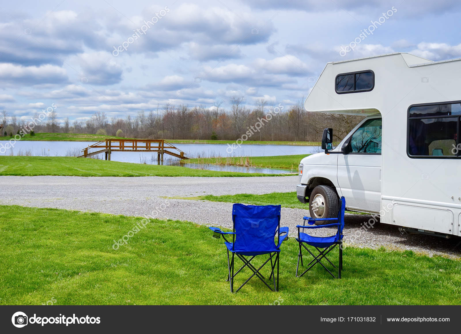 RV (camper) And Chairs In Camping, Family Vacation Travel, Holiday Trip In
