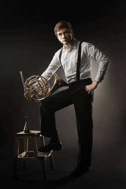 French horn player. Classical musician portrait