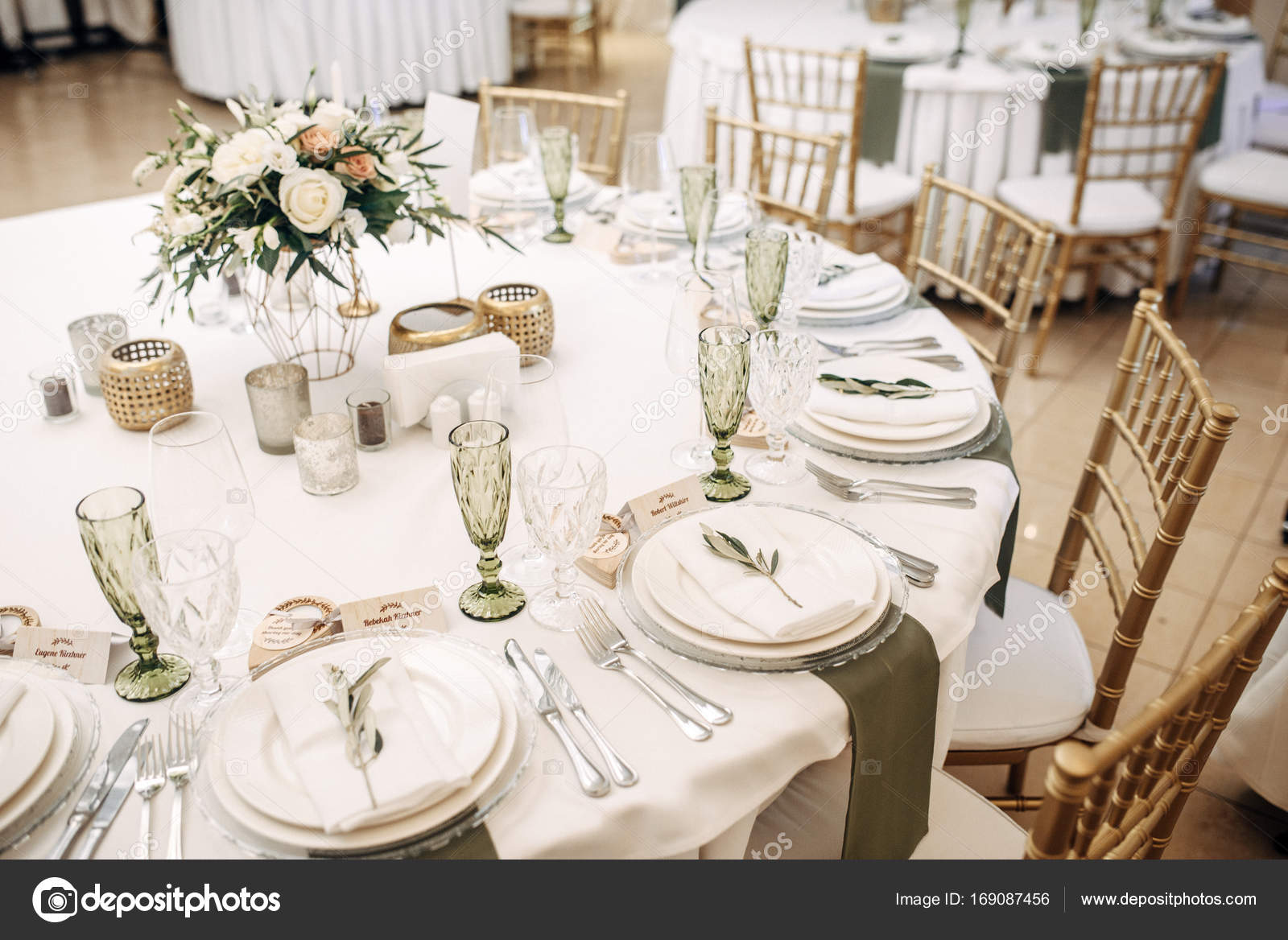White Wedding Table Decorated With Flowers And Eucalyptus Plates
