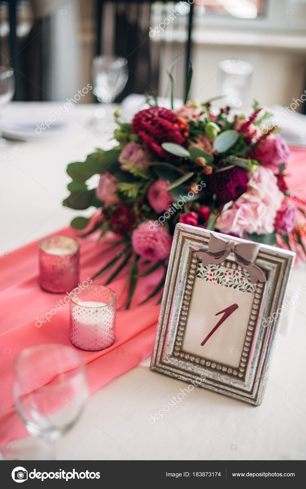 Table number in silver frame with a numeral one, burgundy bouquet on ...