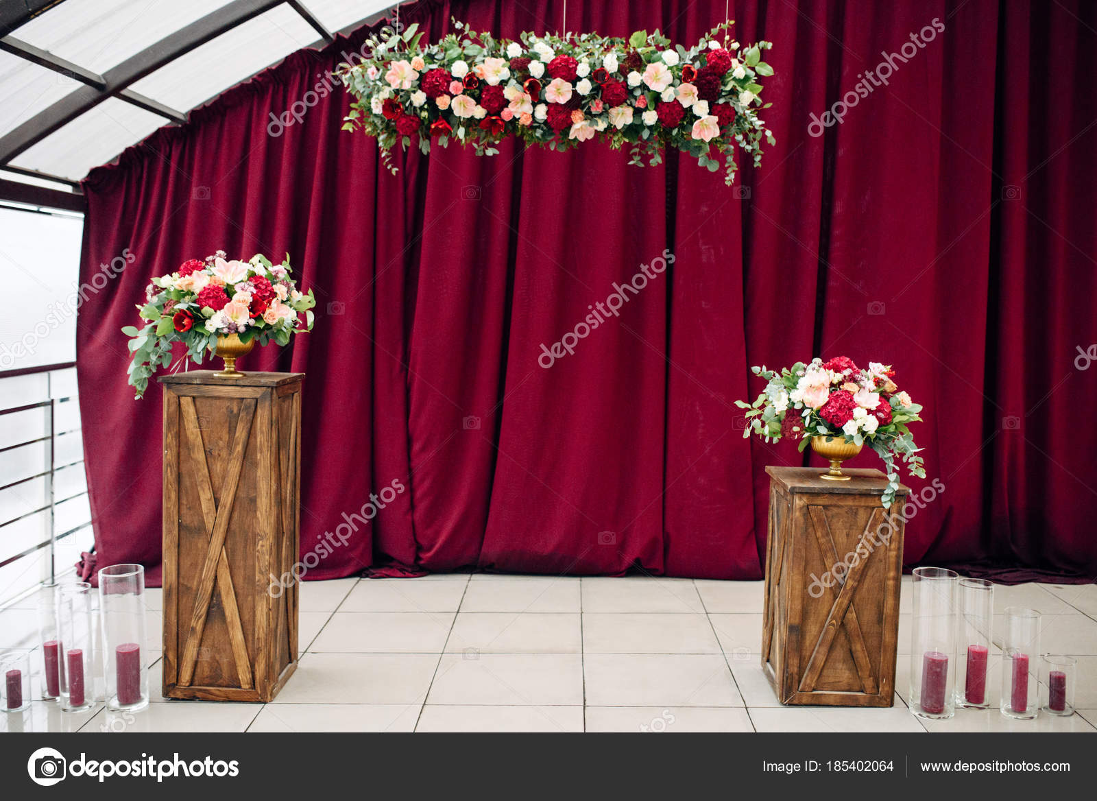 Two luxurious bouquets with white and purple flowers in a vase on a two luxurious bouquets with white and purple flowers in a vase on a wooden stands izmirmasajfo