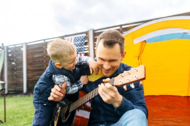 Father and toddler son spend time together