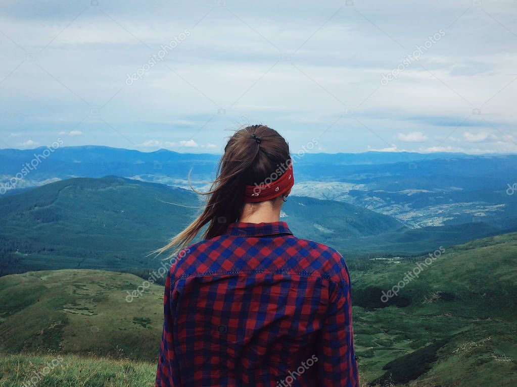 woman looking at mountains view