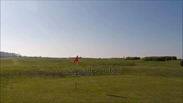 Golfové hřiště, vlajka v díře