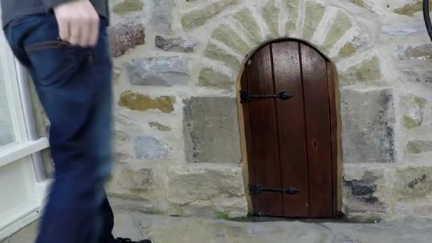 Small door in a wall, Skipton, UK