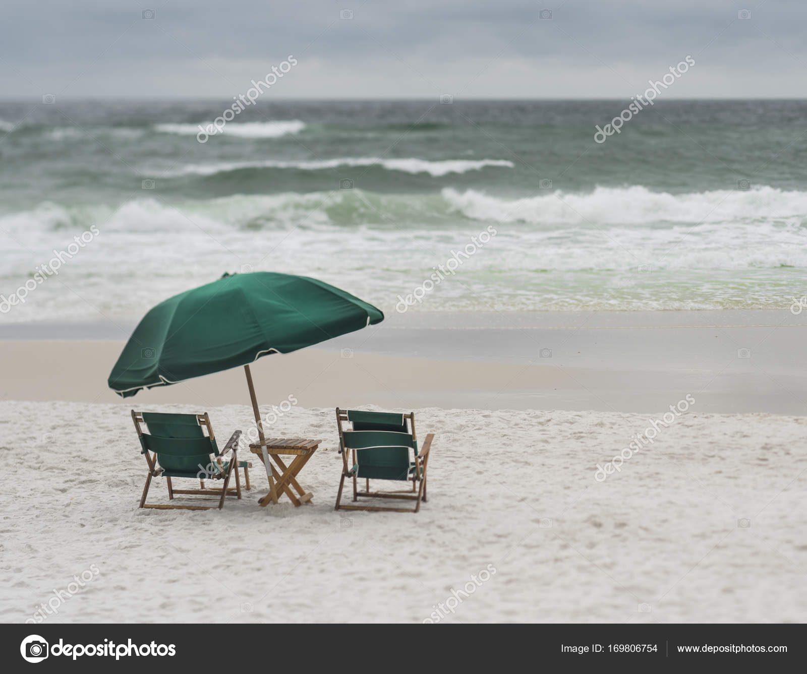 Two Vintage Wood And Canvas Lounge Chairs And Large Umbrella Overlooking  Stormy Day At A Florida Beach. Photo Taken With A Tilt Shift Lens, Creative  Depth ...
