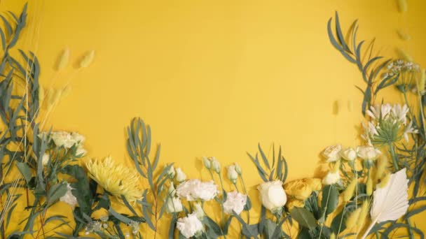 floristry, natural flowers on yellow paper background with a place for your text