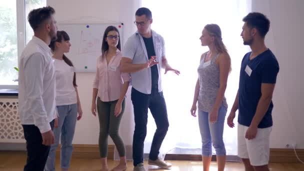 team building, young people perform an exercise together and then applauded each other on group therapy