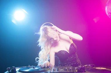 DJ girl on decks on the party